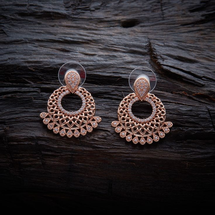 Desiger CZ Zircon Stud earrings studded with synthetic stones, with Rose gold Polish.