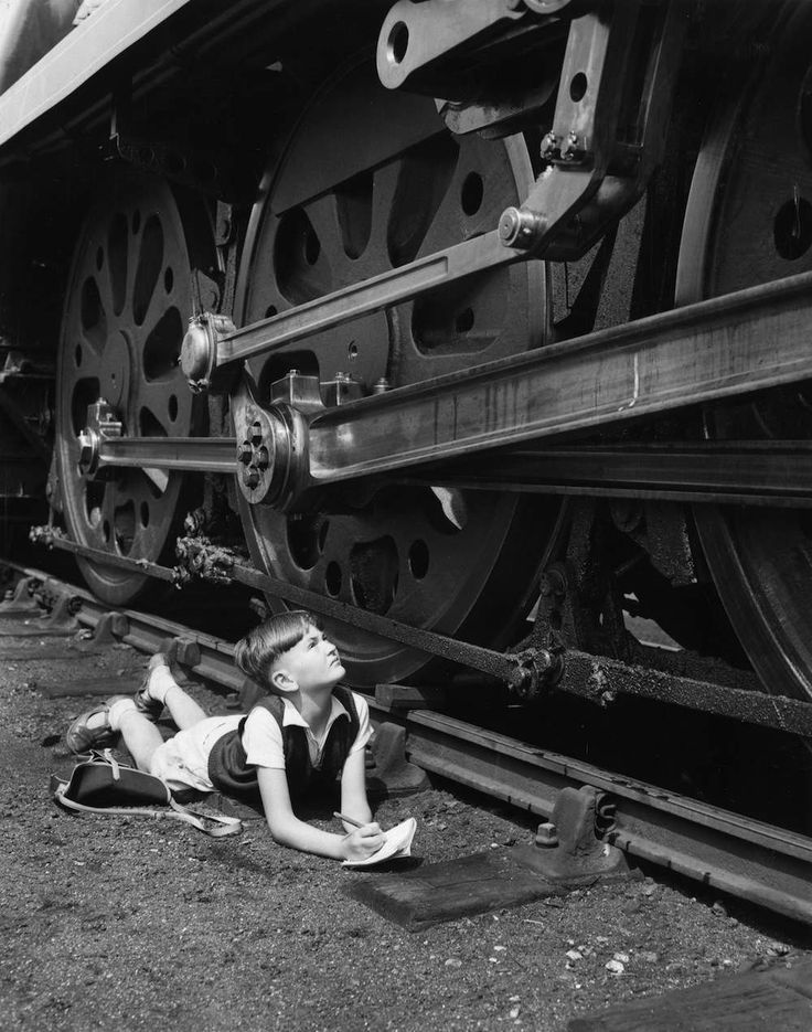 3rd August 1960: Ten year old trainspotter John Speed of Fareham, Hampshire, examining a Battle of Britain Class locomotive at the Southern Region British Railways Works at Eastleigh. (Photo by William Vanderson/Fox Photos/Getty Images)