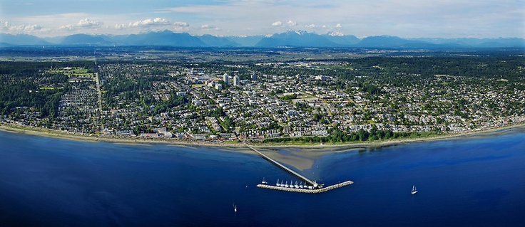 Gorgeous #WhiteRock Aerial Photo - OCEAN VIEWS from  an Aerial Panorama. A stunning aerial panorama of White Rock, The Pier, The White Rock, most of the town with the Fraser Valley and the coast mountains in the background.