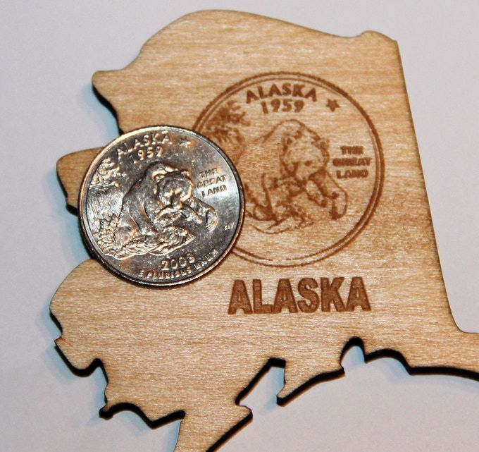 Magnetic puzzle map of the USA, laser engraved into the wood and decorated with the quarter design of each state.