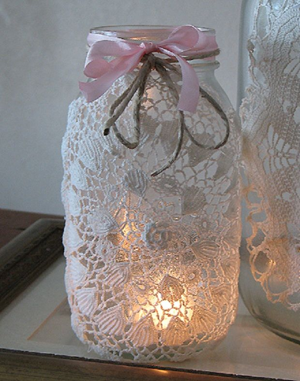 Jar, covered with lace and tied w/ribbon and twine, candle