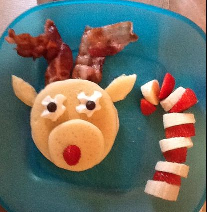 Reindeer pancake with a side of candy cane (strawberries and bananas) for Christmas breakfast! Lainey will love this!