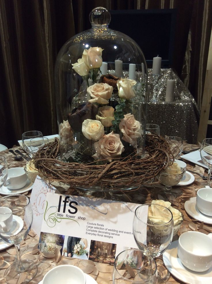 Our glass clotche on a glass plate with silk and live roses
