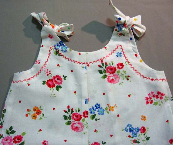 Baby girls dress and bloomers pdf sewing pattern -- INTERMEDIATE PATTERN  If you loved the Rose Bud Romper but it is too baby-ish for your little one, now you can get the same look for babies from 6 months to little girls up to 6 years old. Beautiful ruffled dress and coordinating bloomers --- great for littlies in diapers. You can make the dress for older kids without the pants. Features tie-up shoulders and glossy machine embroidery top stitching on the neckline, frills and bloomers…