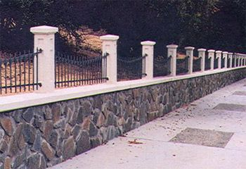 wall with wrought iron fencing offers some privacy, would have wrought iron higher