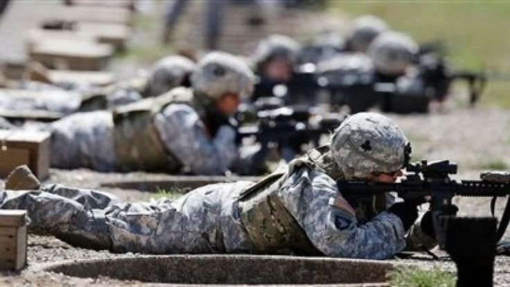 White House, Pentagon back requiring women to register for military draft  Sept. 18, 2012: Female soldiers train on a firing range while wearing new body armor in Fort Campbell, Ky