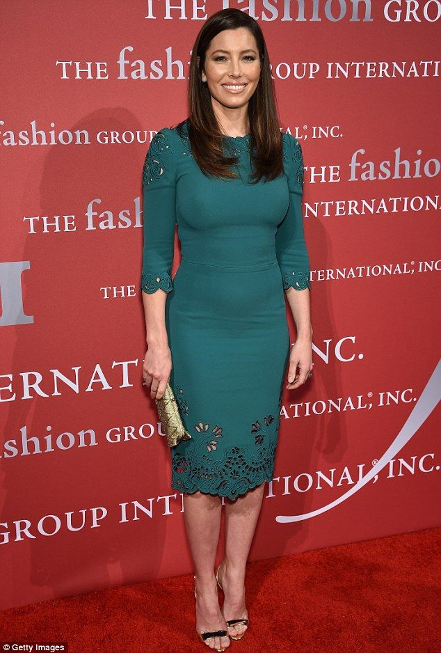 Striking: Jessica looked fantastic in a fitted teal dress and metallic accessories