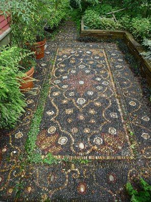 This Persian carpet pebble mosaic that Jeffrey Bale built for a client in Portland is a metaphor for the big bang, with 108 flower-shaped stars or galaxies expanding out into the universe.