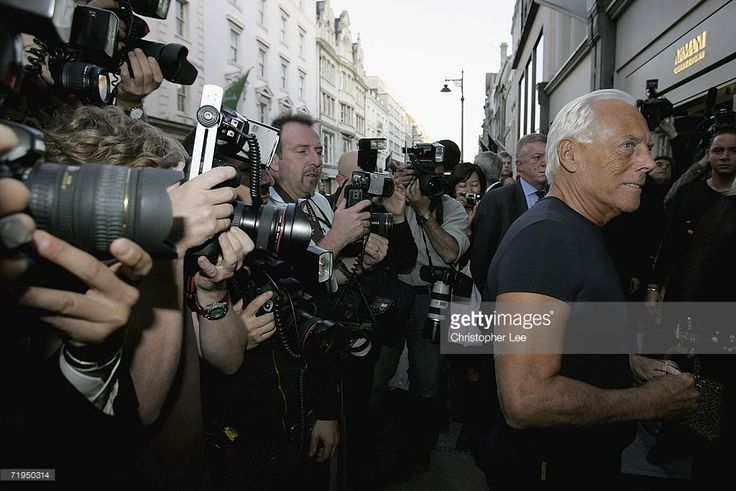 Giorgio Armani (R) waits for the arrival of Chelsea football player Andriy Shevchenko outside the new Armani Casa store on New Bond Street on September 20, 2006 in London, England. Giorgio Armani and Andriy Shevchenko help celebratethe publication of 'Sheva' and the opening of the Armani Casa flagship store in New Bond Street on September 20, 2006 in London, England.
