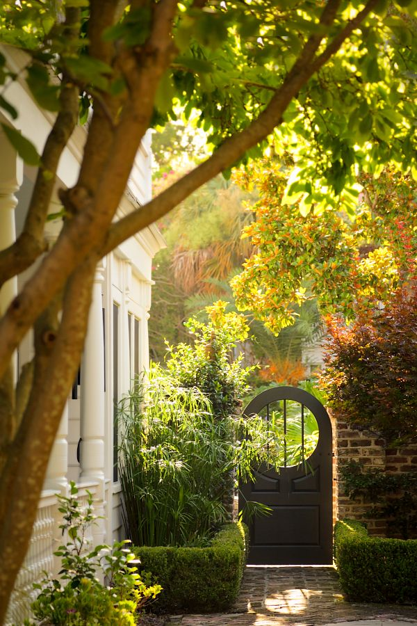 Garden Gates - this arched garden gate and brick walkway make a welcoming entryway into the garden - Style Estate  ANNE: VERY GOOD SIGHT