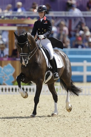 Charlotte Dujardin of Great Britain rides Valegro during the equestrian dressage competition at the 2012 Summer Olympics Aug. 3.