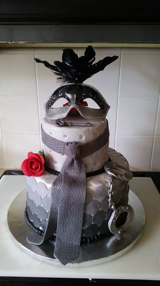 Fifty Shades Darker themed cake made with delicious red velvet cake, rose and masquerade accents.