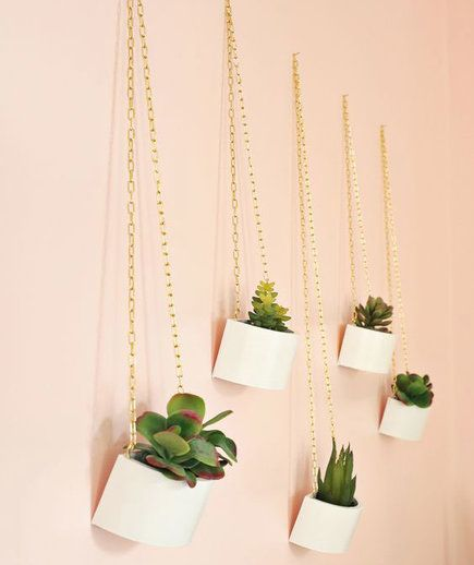 Gold Chain Hanging Planters | Your backyard might be out of commission until next spring, but that doesn't mean you can't enjoy some fresh greenery during these colder months. Breathe some life into your space with lush indoor plant ideas.