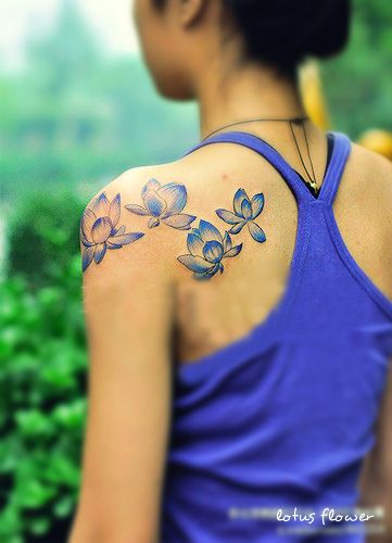 light blue lotus flower tattoo designs on the back-i think one on the foot would be nice :)  I like this for the color