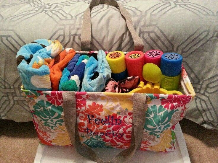 Use the large utility tote from Thirty-One to bring everything you need to the beach or pool. It will hold several towels, sun screen, toys, food, drinks, and more. #beach #pool #travel. Click on the link to customize your own now.