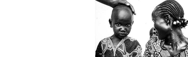 South Sudanese child and woman with baby in Moyo in Uganda 2005.