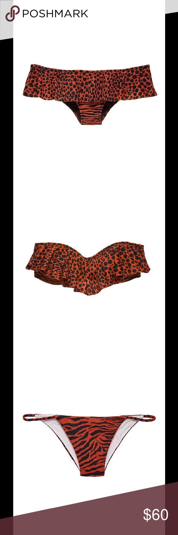 Victoria Secret bathing suit set Patchouli Cheetah Flounce Bandeau & Flounce Cheeky set in animal print. Top: strapless suit that's wrapped in a ruffle. Removable padding for no show-through Back hook closure Removable halter strap Hand wash Imported nylon/spandex.                                          Bottom: Fun in the sun starts with this cheeky suit, wrapped in a ruffle and cut to reveal. Low rise Cheeky coverage: Medium back, reveals a little, but not all Lined In smooth matte fabric…