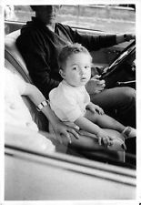 Vintage photo of Brigitte Bardot`s son sitting in a car. -