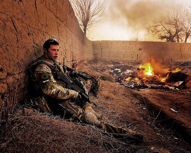 A Royal Marine with Bravo Company, 40 Commando Royal Marines, takes a rest during a patrol in the vicinity of Patrol Base 5, in the region of Narh-e-Saraj, Central Helmand, Afghanistan. The purpose of the patrol was to deter insurgents in the surrounding area and conduct a show of presence.