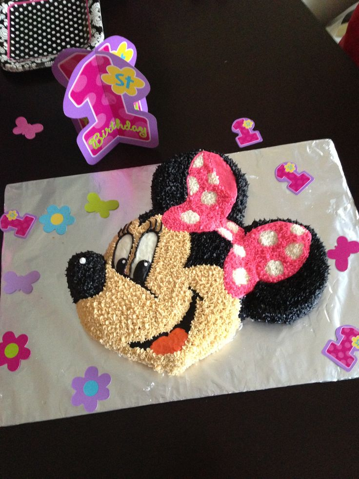 Baby girl loves Minnie and Mickey.  So for her first birthday I used a Mickey Mouse cake pan I already had and piped on a Minnie bow and added some eye lashes.  I love how it turned out.