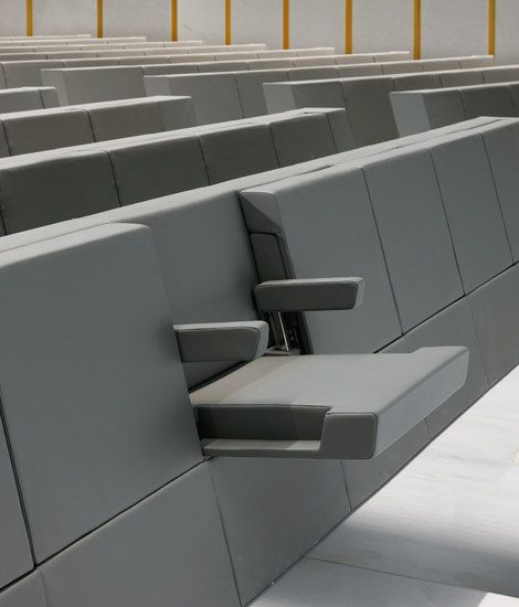 Designed and created specifically for the Aula Magna at the new Bocconi University campus in Milan, the Genya armchair uses the stylistic features, minimalist spirit and austere appearance of the building designed by Grafton Architects,