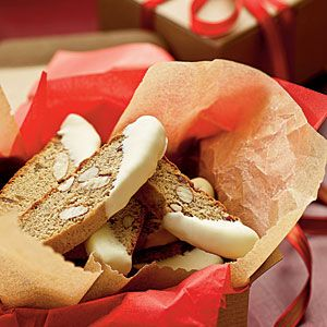 """Gingerbread biscotti dipped in white chocolate. """"Fresh ginger delivers a bit of spice to this traditional Italian cookie."""" Mmm..."""