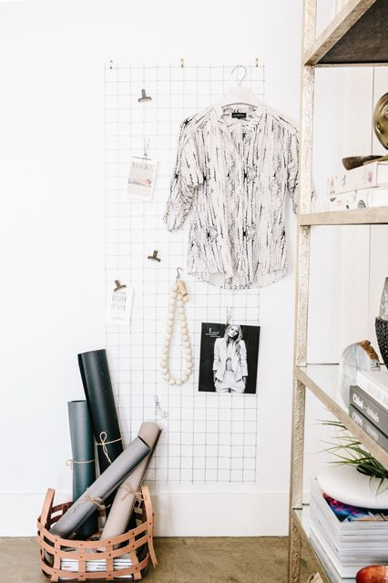 """I did a little DIY to replicate one of my favorite Scandinavian design trends: a metal wall rack. We simply picked up some wire mesh from the hardware store, cut it down to size, and spray-painted it white. It's a fun way to add texture to a room and a great place to create a mood board."""