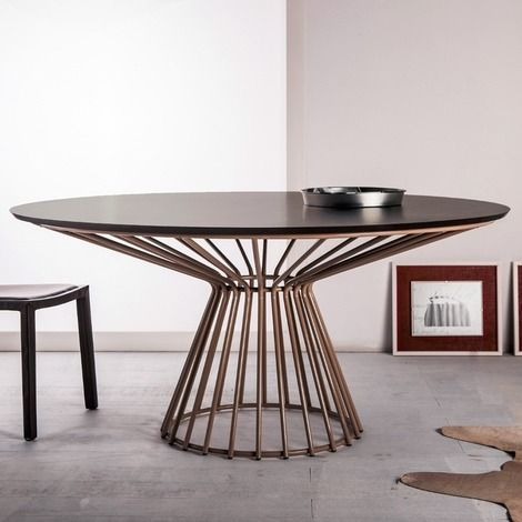 Carlisle round dining table features painted spoke base with colored glass or wood top. Details Available in white or black painted steel base with colored glas