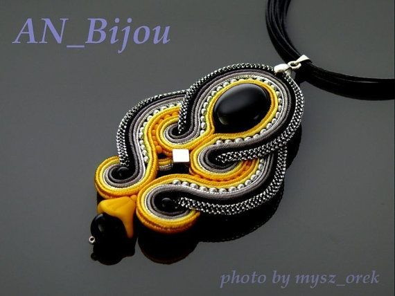 Beautiful, impressive soutache pendant, made from Soutache strings, Onyx and glass beads.    Pendant have been impregnated.    Full length: 3 inches.