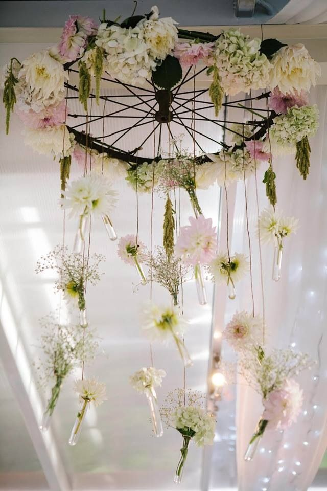 Bicycle wheel chandelier - don't include the hanging flowers but instead candles