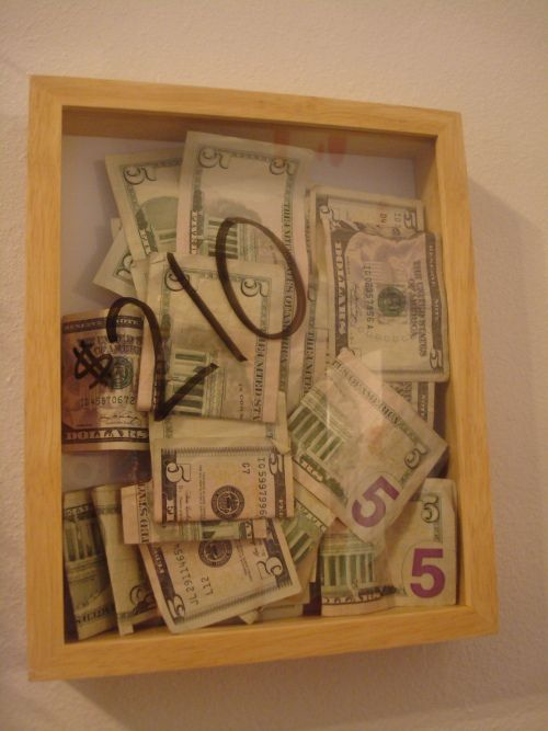 save cash.spare change in a shadowbox and keep track with a dry erase marker - cute idea!