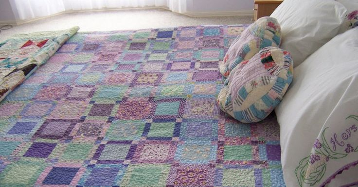 My lavender bed quilt is done. There's not really much to say about it; it's just a bed quilt.  Just a humble bed quilt made from my lavende...