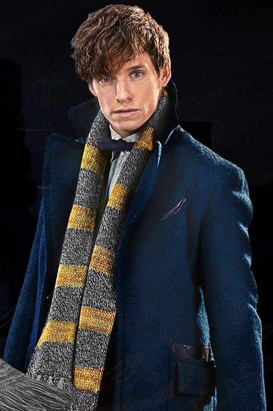 "bespokeredmayne: ""Fantastic! Portrait of Eddie Redmayne in full Newt Scamander regalia, peacock blue topcoat, fringed scarf and all. """