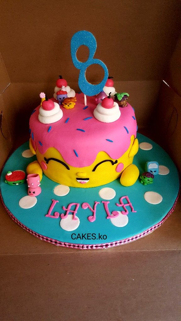 Did this Shopkins cake for a little princess celebrating her 8th birthday  .Click link to my business page for more of my work.