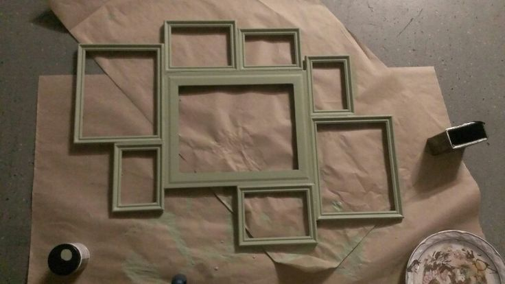 Create a collage frame from multiple frames & make your own design. Used gorilla glue to attach together. Then sand and paint whatever color you would like. I just used the flat paint sample from Home Depot for $2+. Easy and personalized :) just add a saw hook or two to hang on wall :)