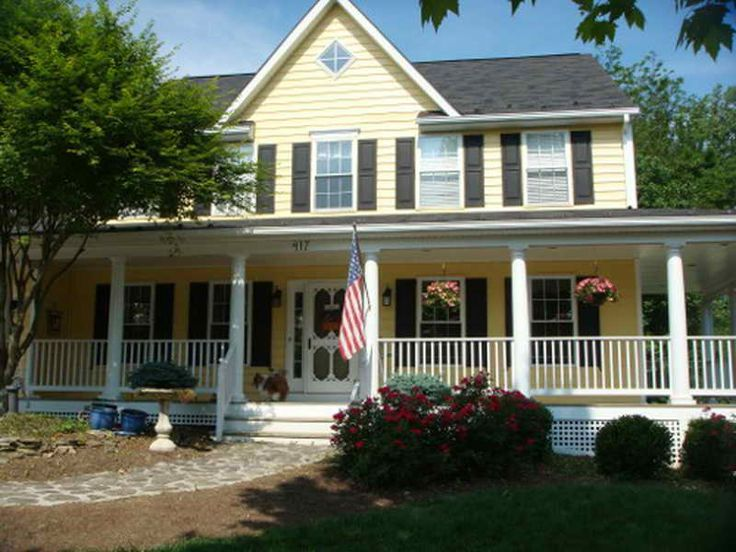 love the yellow siding and large porch would prefer white shutter to. Black Bedroom Furniture Sets. Home Design Ideas