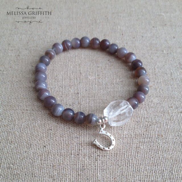 Botswana Agate Lucky Horseshoe Bracelet (MGB98) $38.00  This bracelet features 5mm round Botswana agate beads and a single faceted quartz nugget. A lucky horseshoe charm is surrounded by sterling silver beads. Beads are strung onto a high quality stretch cord. Fits a 6-6.5 inch wrist. Larger size can be made upon request.