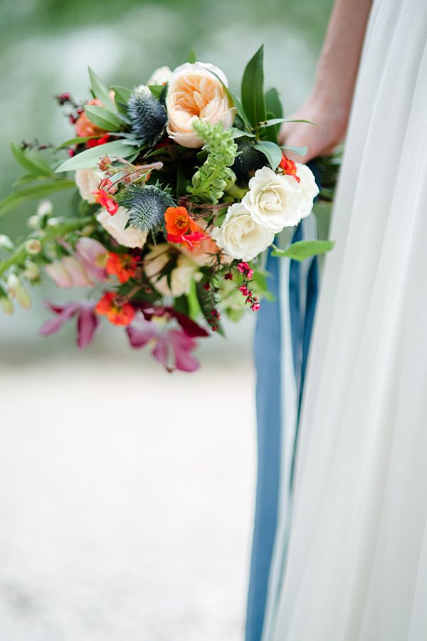 orange and blue wedding bouquets - photo by Kayla Snell http://ruffledblog.com/Cobalt-And-Orange-Midcentury-Wedding-Inspiration