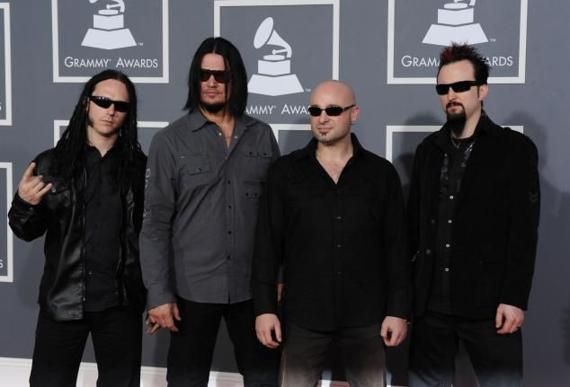 Warner Bros. pulls ad for Disturbed album after news crew shooting Depicts otherworldly being shooting everyone in television station