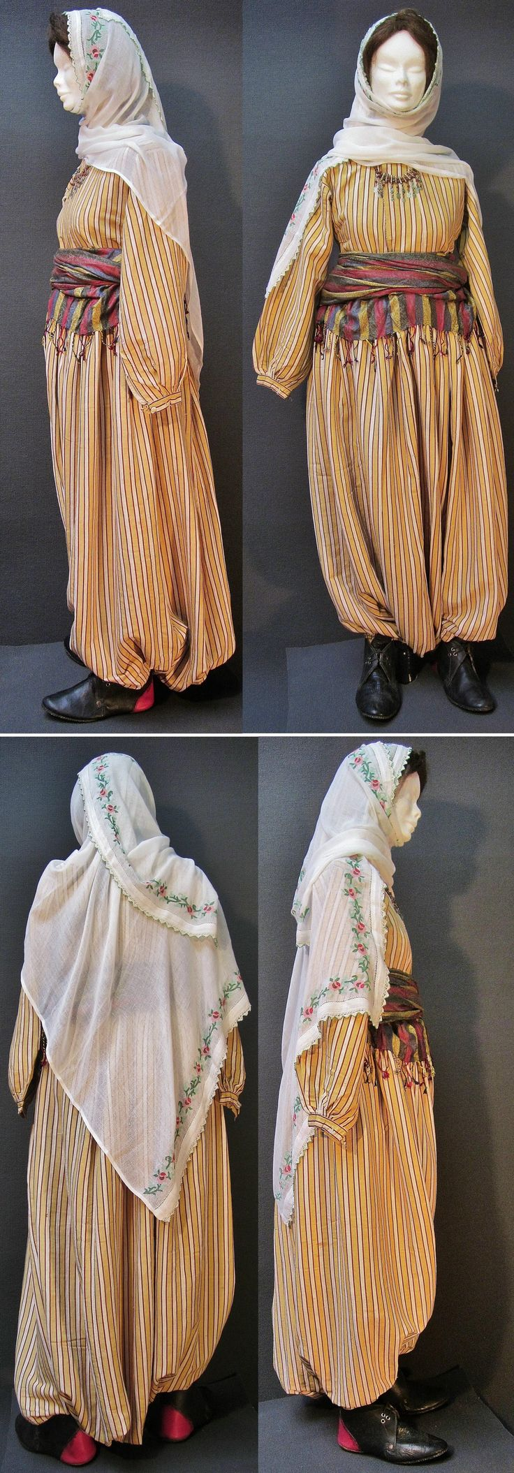 A traditional daily costume from the Konya province.  Middle-class urban style, worn at home, ca. 1900-1925.  Containing: a silk ensemble ('gömlek'/shirt + 'şalvar'/baggy trousers),  a large embroidered 'yazma' (headscarf), a silk  'kuşak' (waist band) and low boots-like leather shoeware. (Kavak Costume Collection - Antwerpen/Belgium).