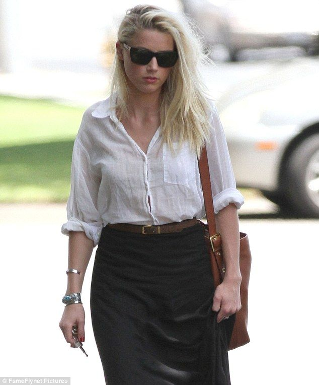 Chin up: Amber Heard looked sombre as she was spotted out and about in Burbank, California, yesterday  love this match