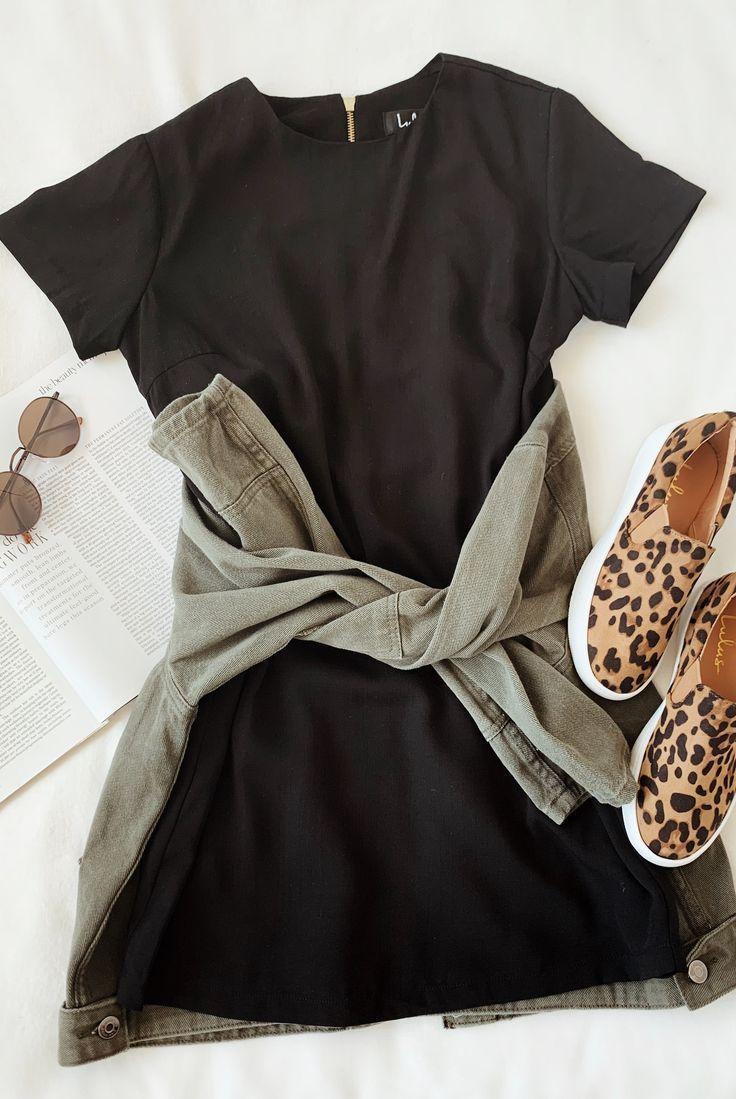 A versatile black shift dress to run errands in while looking fashion-forward. L…
