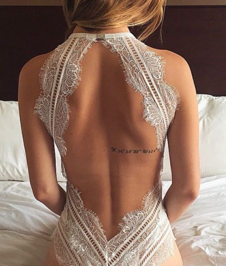Backless lace bodysuit with a delicate back tattoo