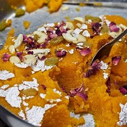 Rava Kesari - A simple five ingredient traditional South India dessert that is perfect served still warm with a sprinkling of cashews, raisins and dried rose petals.