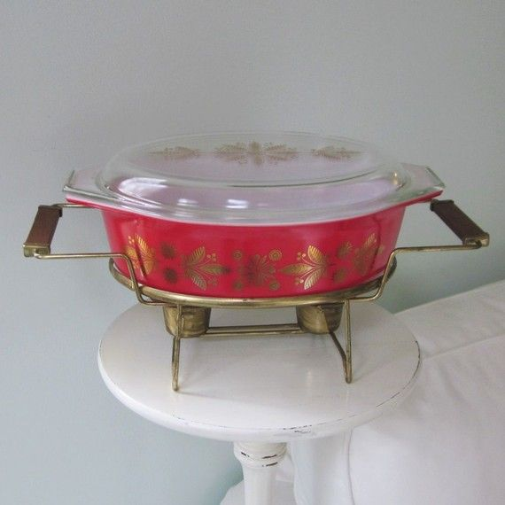 Pyrex Golden Poinsettia casserole. Picked this up at Goodwill on a whim only to discover it's a promotional items and a bit hard to find. It will be perfect for holiday parties we go to. Now if only I could find the warmer!