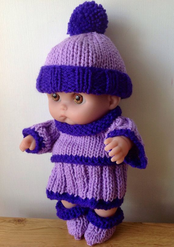 The outfit consists of a lilac and purple jumper, matching skirt, pom pom hat, boots and pants. All are designed by me and are hand knitted using baby antibacterial yarn and then sewn by hand. They are machine washable at 40 degrees and have Velcro fastenings rather than for little hands.