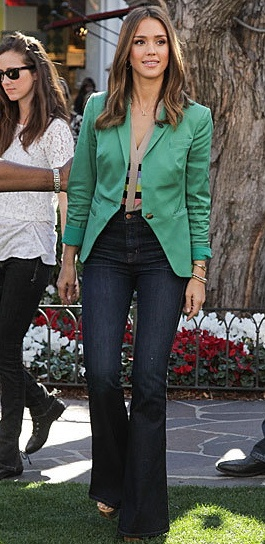 #JessicaAlba : Green Jacket with High Waisted Denim Pants. What a fun look! Top this cute outfit off with a pair of heels! Shop #DMLooks at DivaMall.tv
