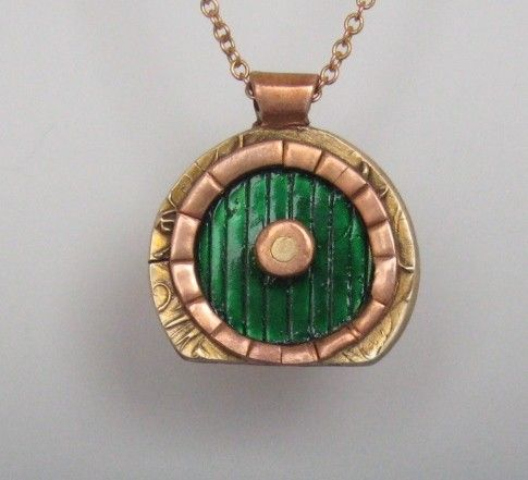 It's a hobbit door... :D Awww! Hobbit House necklace $45