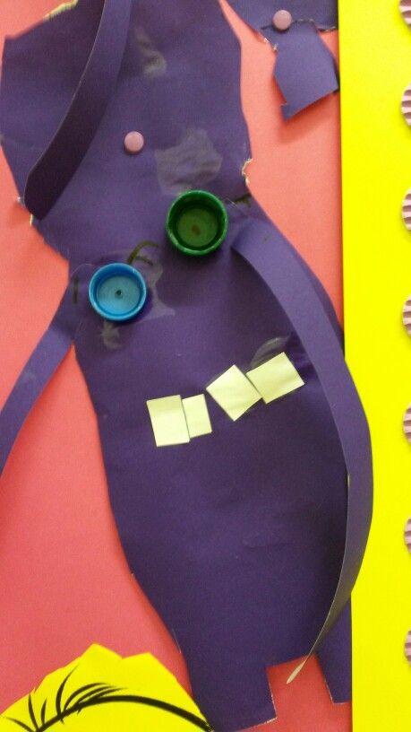 Make you own evil minion. Bottle lids for eye/eyes. White paper teeth. Easy.