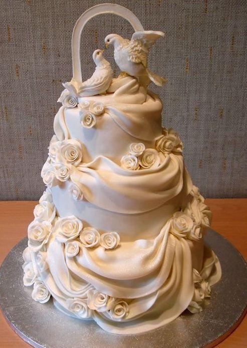 Doves and white drapes 3 tier wedding cake.JPG